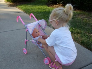 Clare strapping in her baby doll